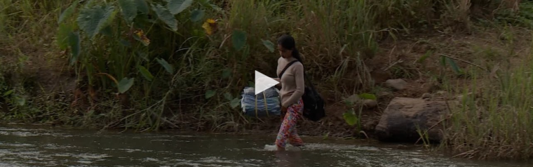 Woman crossing a river