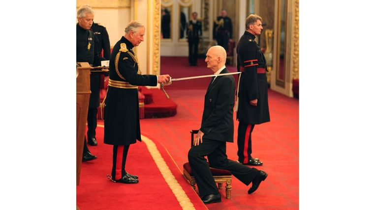 Nick White being knighted