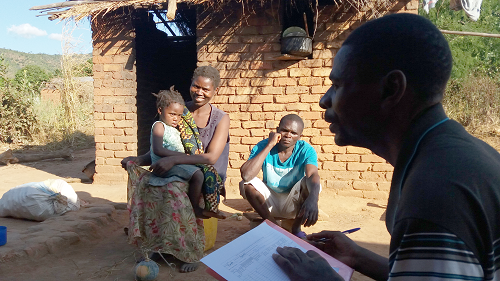 Researcher working with local people