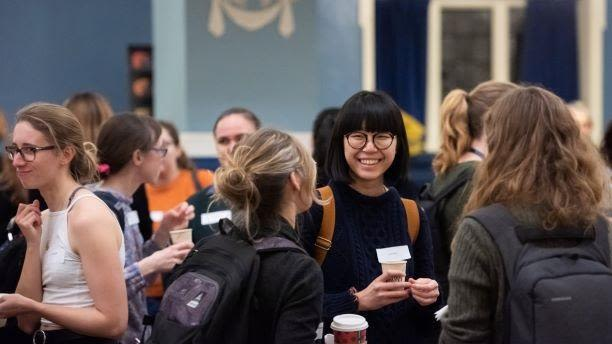 Women researchers at a networking event
