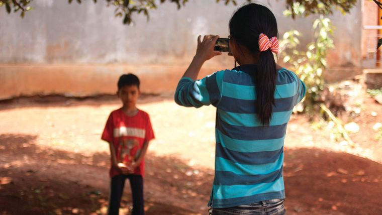 Child taking a picture of another child