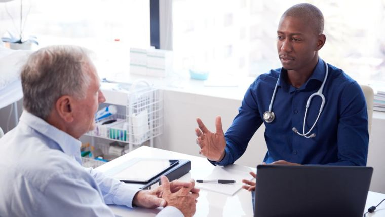 Image of a GP and patient during a consultation
