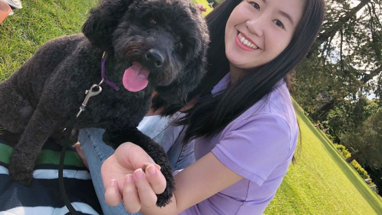 Photo of Ding-lan and Koko (a dog) in the park