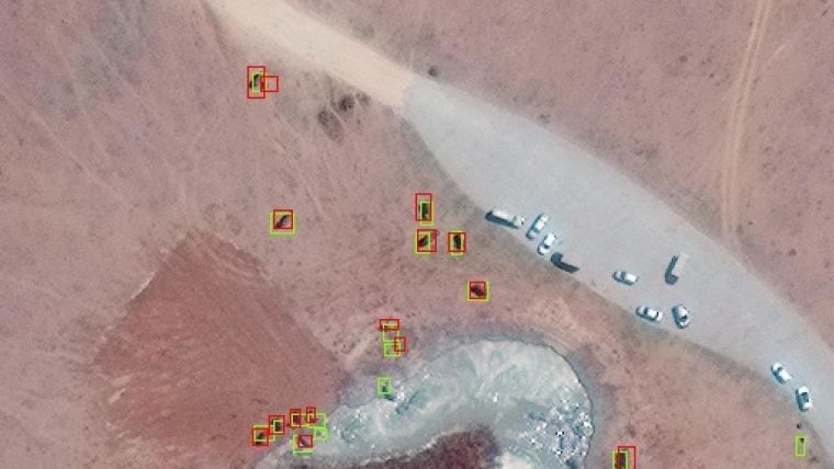 Worldview-3 Satellite images of elephants on the ground.