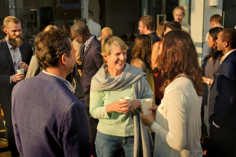 Diverse group of people mingling at event