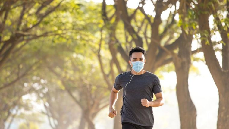 A jogger wearing a mask
