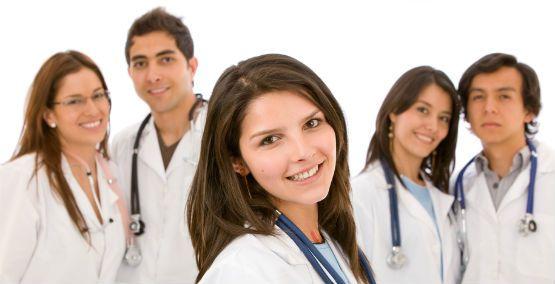 Five smiling medical students