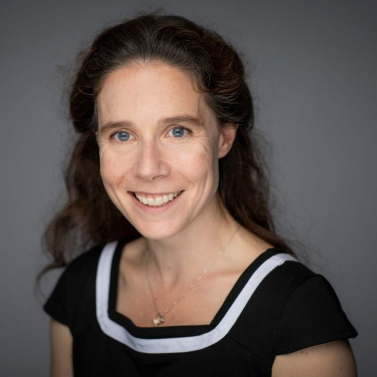 Eleanor Stride's staff profile picture before a grey backdrop