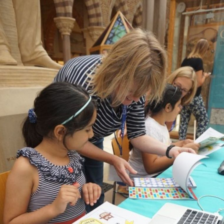 Kate Nation works with a young child at a public engagement event at the Natural History museum