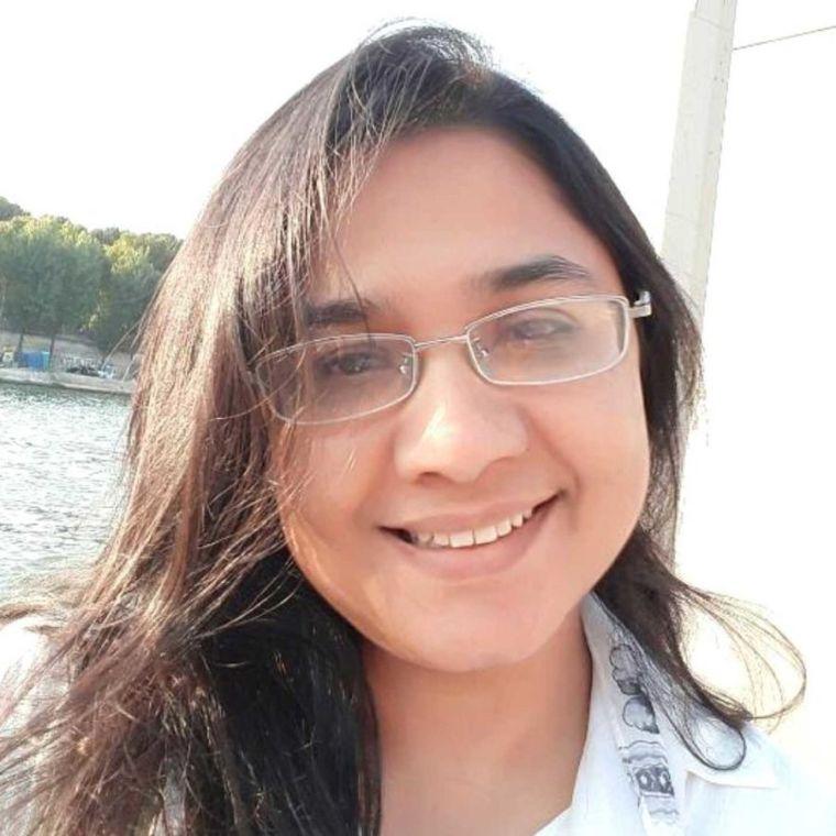Rizwana Rashid smiles on a sunny day
