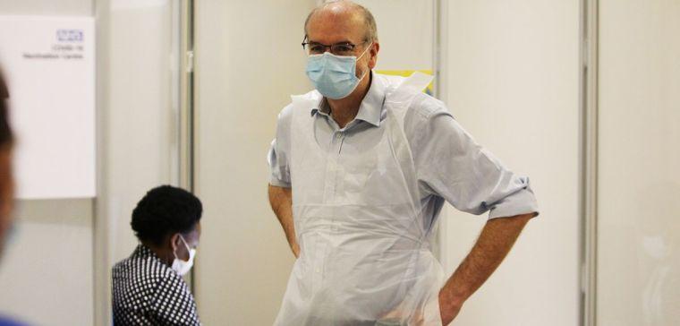 Prof. Pollard preparing to deliver coronavirus vaccinations at the Kassam Stadium