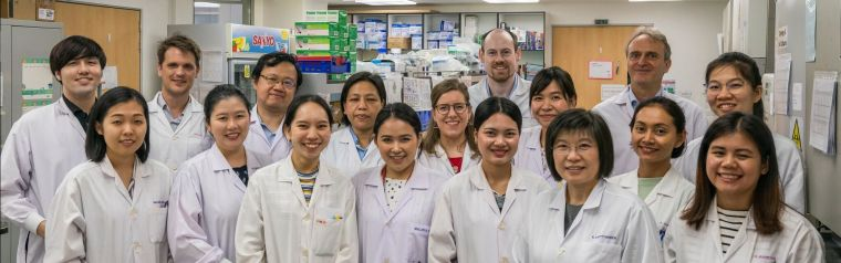 A group photo of Arjen Dondorp, Head of Malaria with Kesinee Chotivanich and her Malaria Lab team.