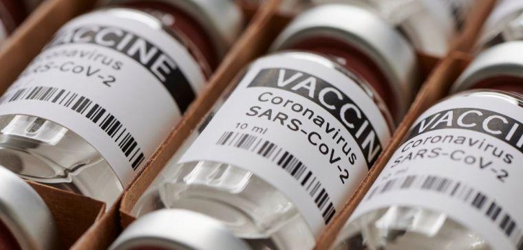 Dummy vaccine vials in a rack