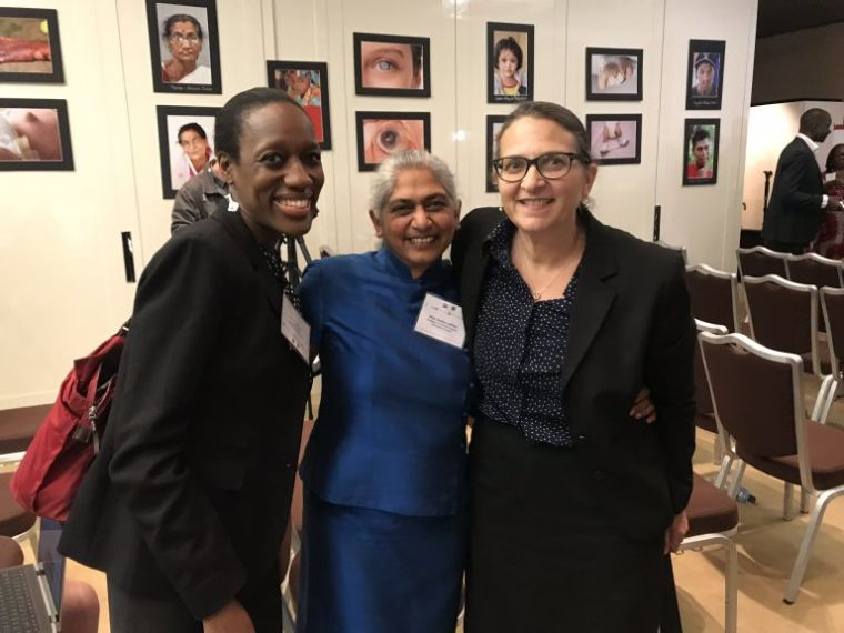 Professor Kokila Lakhoo with two colleagues at the 72nd World Health Assembly in Geneva.