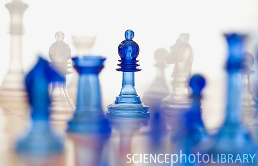 Blue translucent chess figures on board (stock photo)