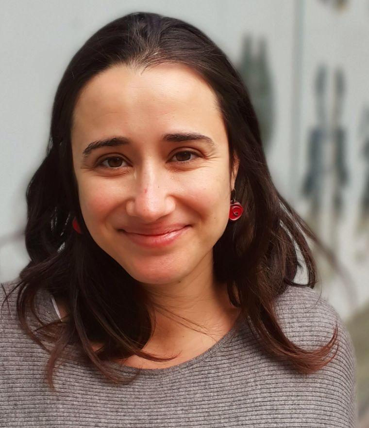 Carina Monica smiles in her staff profile picture