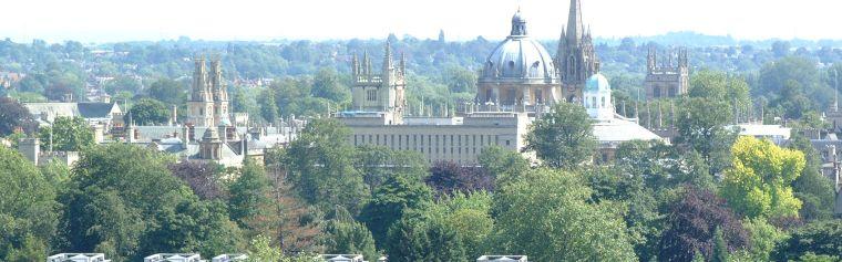 High shot over rooftops showing key landmarks including the Radcliffe Camera.
