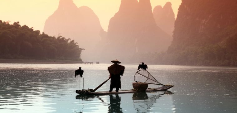 Chinese fisherman in a boat on a lake