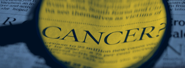 The word cancer under a microscope