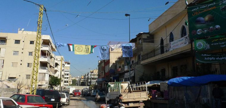 A street in south Beirut where the entrance to the camp is located, with a couple of Palestine flags overhead