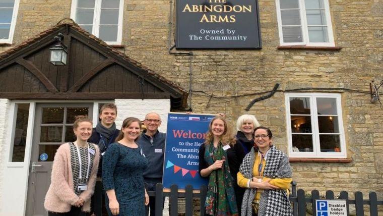 The team stood outside community pub in Abingdon