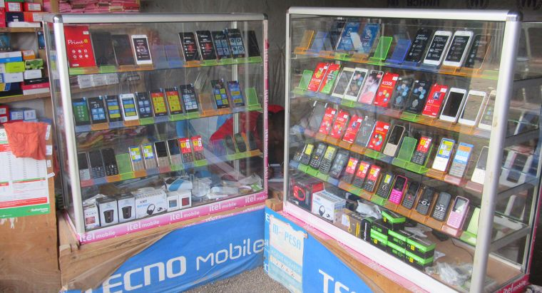 two cabinets of mobile phones for sale