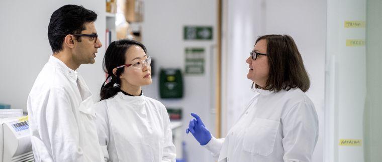 Scientists talking in a lab
