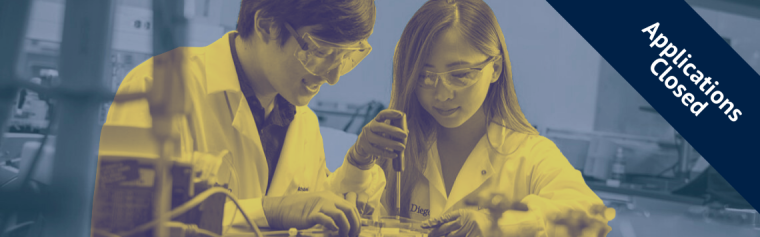 Students at a lab bench using a pipette