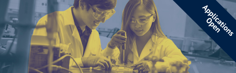 Students pipetting at a bench