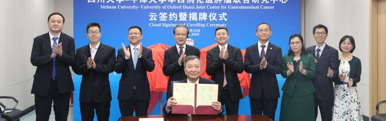 The opening ceremony of the China Hospital Oxford partnership, with Chinese academics unveiling a plaque.