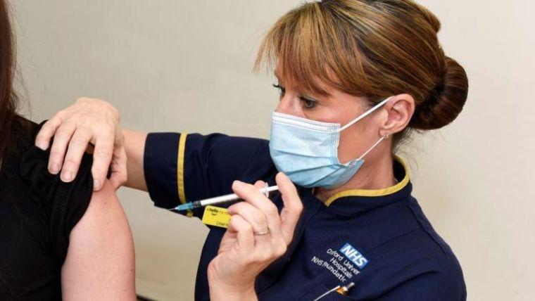 a nurse administering a vaccine