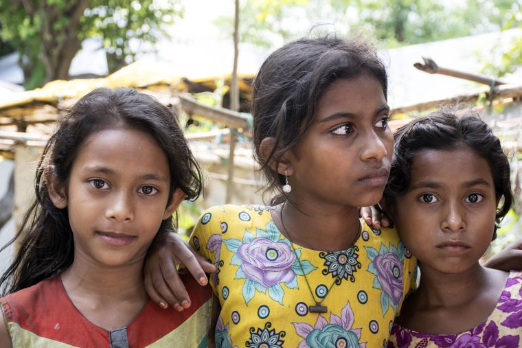Three young girls at a clinic in Asia