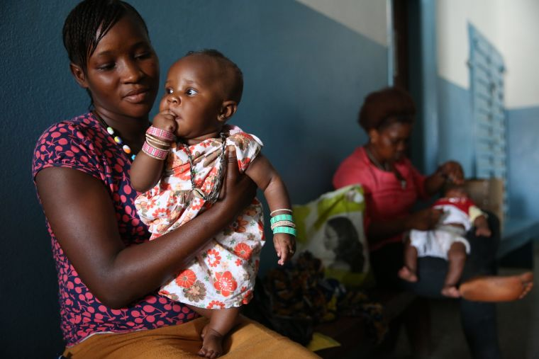 Mother and child, waiting in a health centre