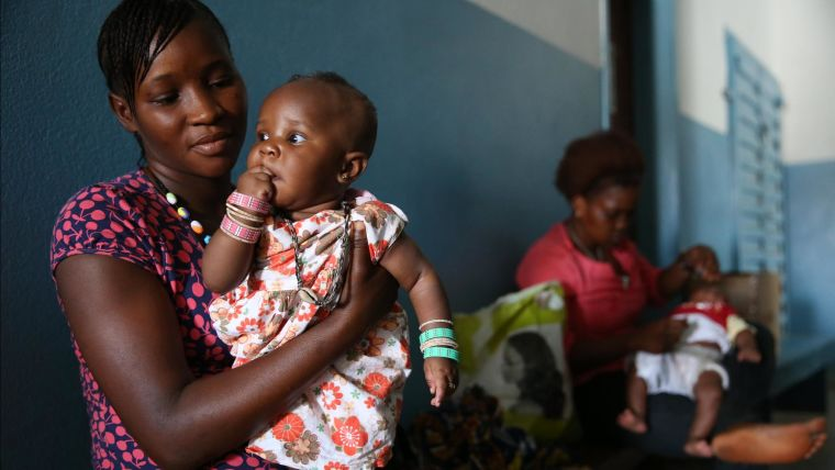 Mother and child, waiting at a health centre