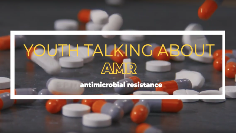 Numerous pills on a table, with the text: Youth talking against AMR - antimicrobial resistance