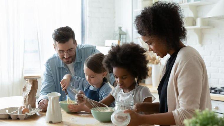 Children and parents cook together
