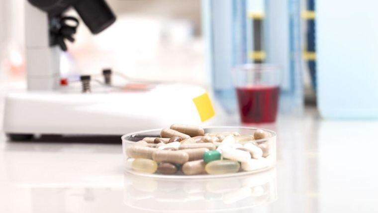 Petri dish containing medication pills