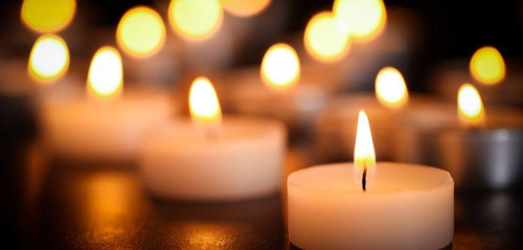 Numerous tealight candles alight
