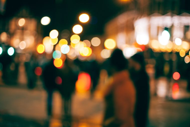Street scene featuring blurred people and lighting