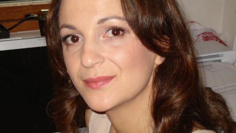 Informal profile photo in Samira's office