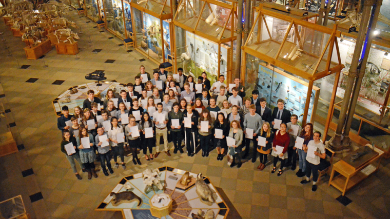 Oxfordshire Young Scientists holding up certificates