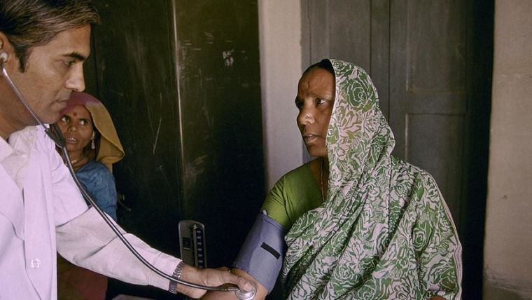 Female patient get a check up in a healthcentre in India