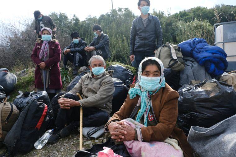 migrants wearing masks