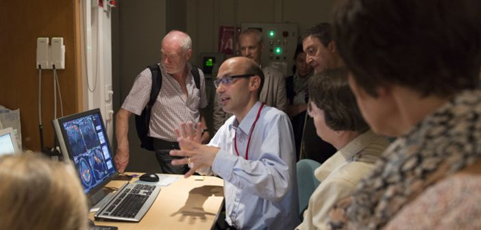 Stuart Clare talking to members of the public about the scanner