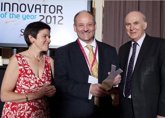 Professor Foster receives his award from the Business Secretary, Vince Cable.