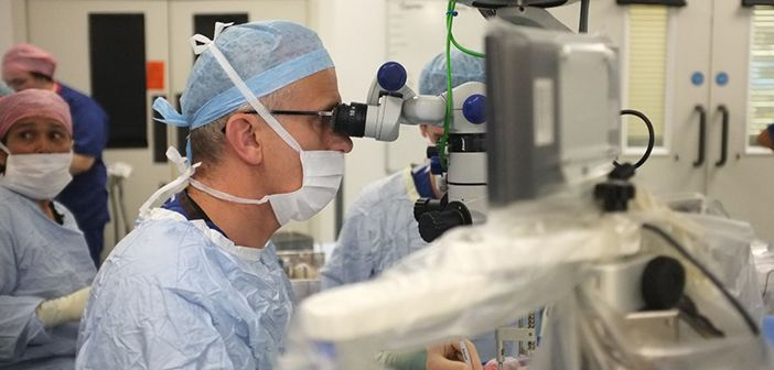Robot-assisted eye surgery: Professor Robert MacLaren steers the robot in its first live operation