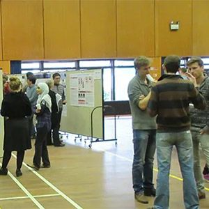 Groups of students at a poster session