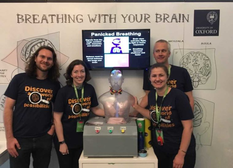 Four researchers and a brain/lungs model at Royal Society Summer Science Exhibition