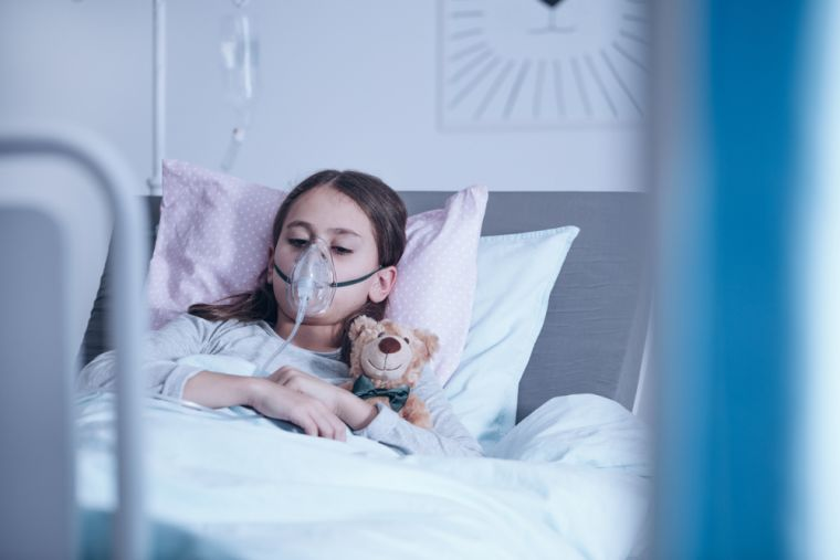 Unwell child in hospital bed