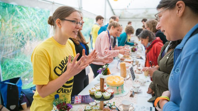 Helen Curtis at the Curiosity Carnival, representing some of the key issues around research integrity through the medium of cake.
